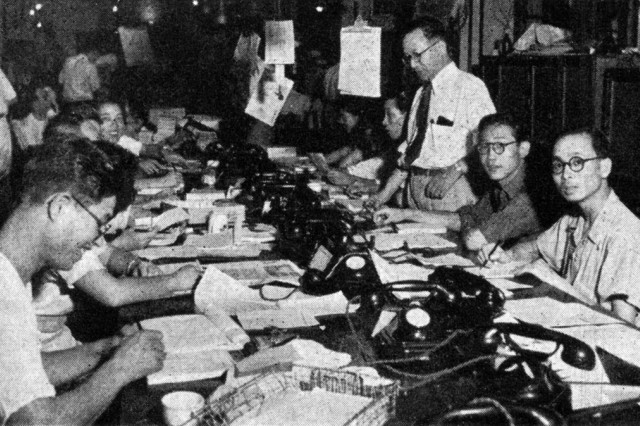 Japan's free press at work. A busy news desk in a Tokyo newspaper office.
