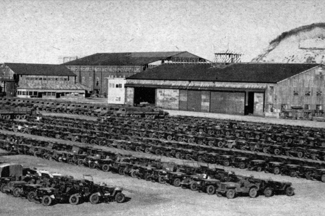 Finished products of BIG-5 operations are these long rows of reclaimed Government vehicles at Oppama Ordnance Depot. During World War II, Oppama served as a Japanese navy seaplane base.