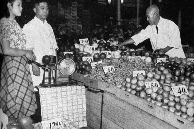 Fully stocked fruit stands reflect the country's steadily increasing food supply.