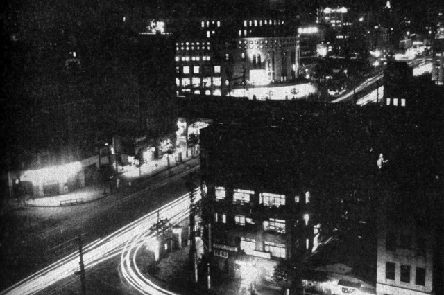 The night scene shows a portion of the capital city's modern metropolitan area.