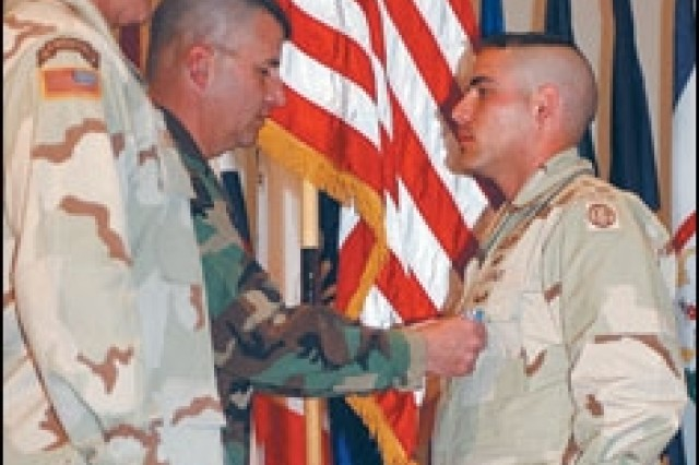 """Staff Sgt. Gerald A. Wolford receives his Silver Star."""""""