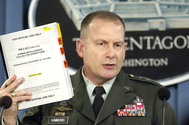 "Lt. Gen. John Kimmons, U.S. Army, holds up a copy of Army Field Manual 2-22.3, ""Human Intelligence Collector Operations"" as he briefs reporters on the details of the manual in the Pentagon Sept. 6. The manual details guidelines for the interrogation of detainees in U.S. military custody."