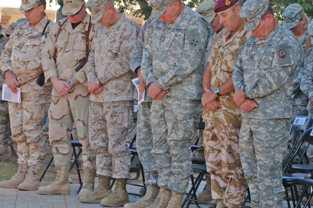 Multi-National Division-Baghdad Commander Maj. Gen. James Thurman (center) and Multi-National Corps-Iraq Command Sgt. Major Ralph Beam (far right) pause for a moment of silence with other MNC-I members during a memorial ceremony Sept. 11 at Al-Faw palace, Camp Victory, Iraq.