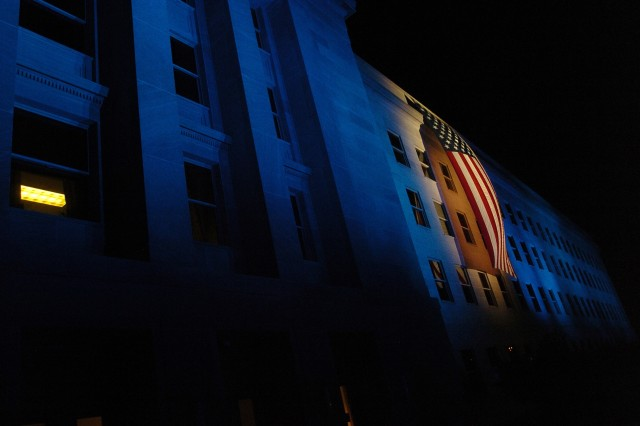 A flag hangs as a memorial during the 2nd annual Freedom Walk at the Pentagon Sept. 10. The flag and lights illuminate the spot where American Airlines Flight 77 crashed into the Pentagon Sept. 11, 2001. The Freedom Walk started at the National Mall in Washington, D.C., and ended at the Pentagon.