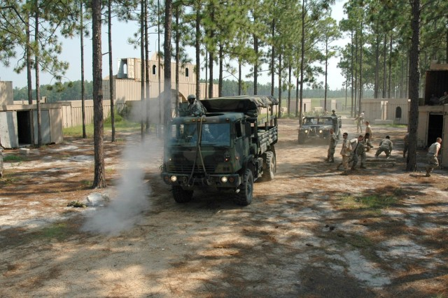 Things started to go wrong for the convoy of 407th Brigade Support Battalion paratroopers right from the beginning. First, they found protestors blocking the road to their objective. Then, they were hit by skirmishers who shot at them from hidden positions beside the road. And finally, they had to fight their way out of a hostile village full of snipers after an improvised explosive device disabled one of their vehicles.