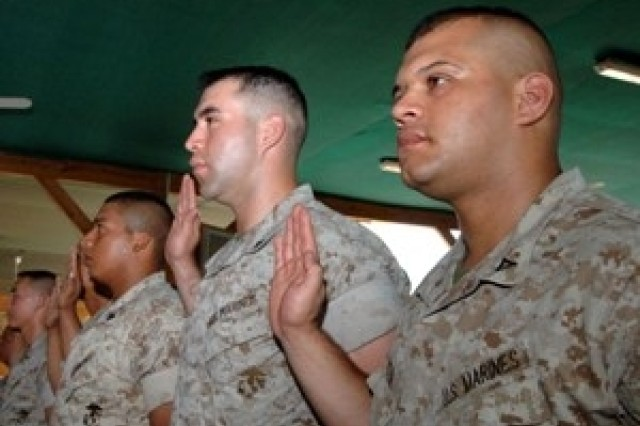Camp Lemonier, Djibouti (September 6, 2006) 20 service members pledge allegiance to the United States, during Camp Lemonier's first Military Naturalization ceremony. Eight countries were represented by the service members, who are currently part of the Combined Joint Task Force - Horn of Africa.