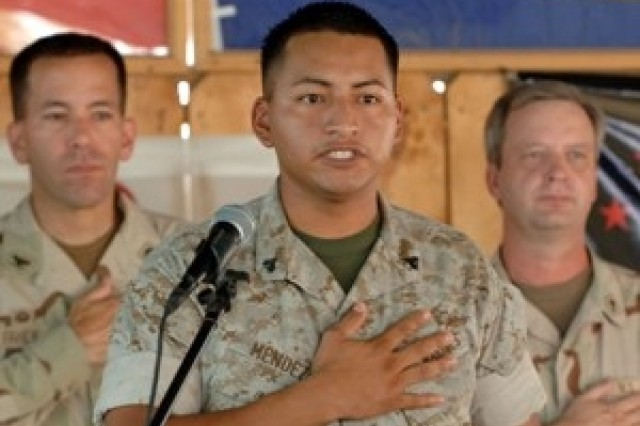 20 service members become U.S. citizens in Djibouti, Africa.