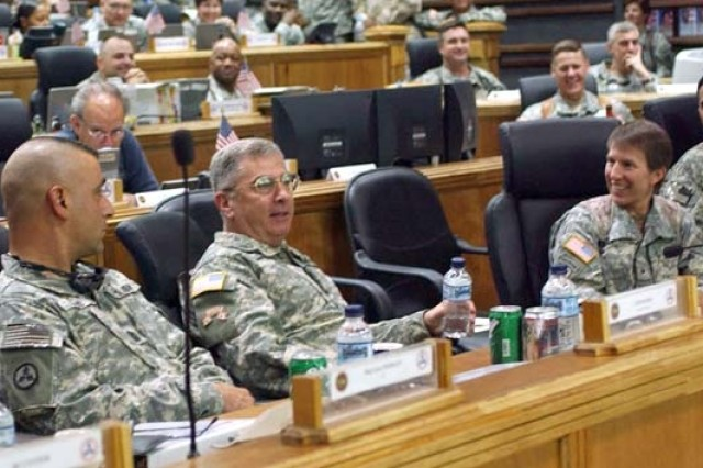 Gen. John Abizaid, the U.S. Central Command commander,(center) joins 3rd COSCOM commander, Brig. Gen. Rebecca Halstead (right) and Command Sgt. Maj. David Wood (left) in a briefing with members of the 3rd COSCOM at the unit's headquarters on LSA Anaconda, Balad, Iraq, Aug. 25.