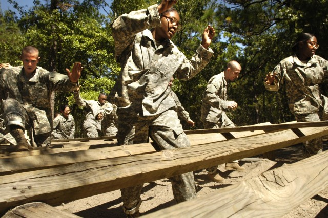 Army recruits negotiate an obstacle during the confidence course portion of basic combat training at Fort Jackson, S.C.