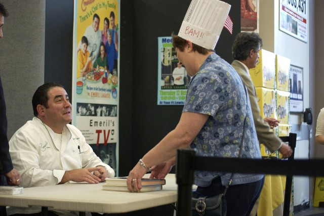 Celebrity chef Emeril Lagasse signs his cookbooks and interacts with fans during a book signing at the Fort Lewis, Wash., Post Exchange Oct. 12.