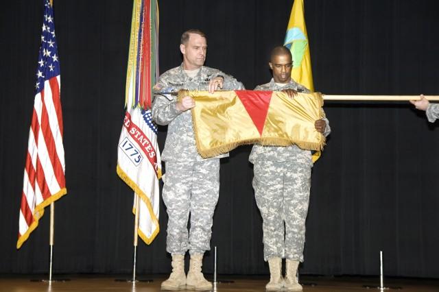 Brig. Gen. John A. Macdonald, left, and Command Sgt. Maj. Willie Ash Jr. furl the Installation Management Agency flag. The IMA flag was cased at the Oct. 24 activation ceremony for the Installation Management Command. Macdonald, IMA's last director, now is the IMCOM deputy commander.