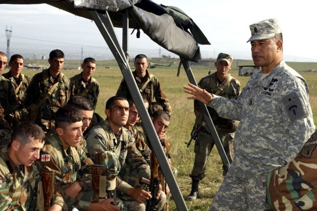 Command Sgt. Maj. Iuniasolua Savusa, U.S. Army, Europe command sergeant major, speaks to a group of troops from the Georgian 33rd Infantry Battalion during a visit to Krtsanisi Training Area, near Tblisi, Georgia.
