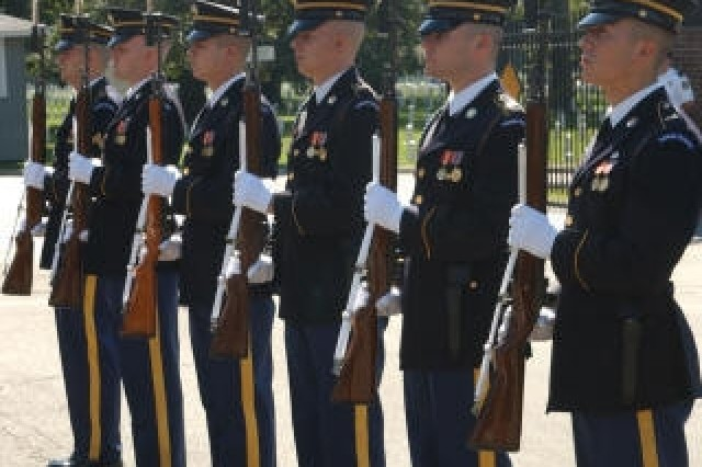 Members of the Old Guard render their salutes immediately after chapel services at Fort Myer, Va., Sept. 26 before the burial of Pvt. Francis Lupo, a 1st Inf. Div. Soldier formerly listed as missing in action during WWI. He was buried in nearby Arlington National Cemetery. Before they were positively identified, Lupo's remains were examined for more than two years after they were found near Soissons, France, in 2003.