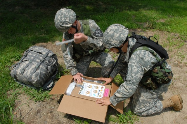 Soldiers pull a tab to activate the Unitized Group Ration-Express. UGR-E modules serve hot meals for up to 18 warfighters without requiring kitchen equipment, cooks, fuel or a power source.