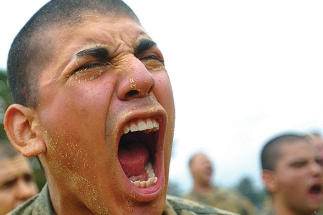 """Army recruits express their motivation during a platoon competition at an obstacle course at Fort Benning, Ga. """""""