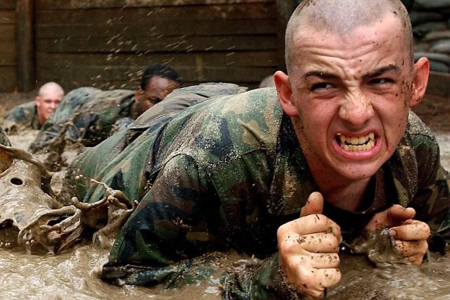 Trainees high crawl through the mud on an obstacle course during Army Basic Combat Training at Fort Jackson, S.C. The nine-week course designed to transform young American volunteers into Soldiers. Photo courtesy of the Department of Defense.