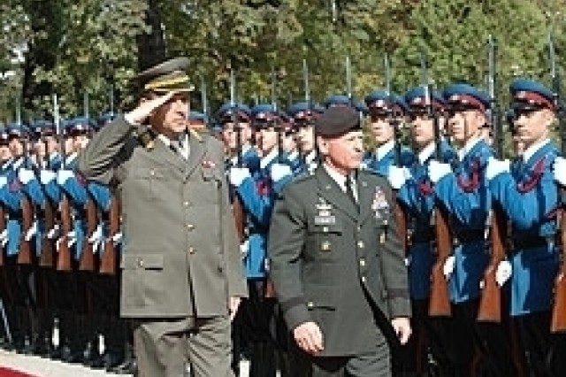 Serbian Chief Reviews Soldiers