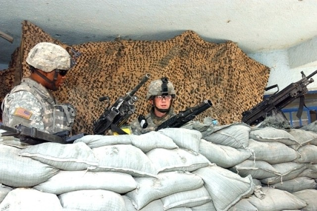 Soldiers from the 463rd Military Police Company, attached to the 1st Brigade Combat Team, 4th Infantry Division, pull security at the Saab al Bour Police Station, Oct. 27, 2006.