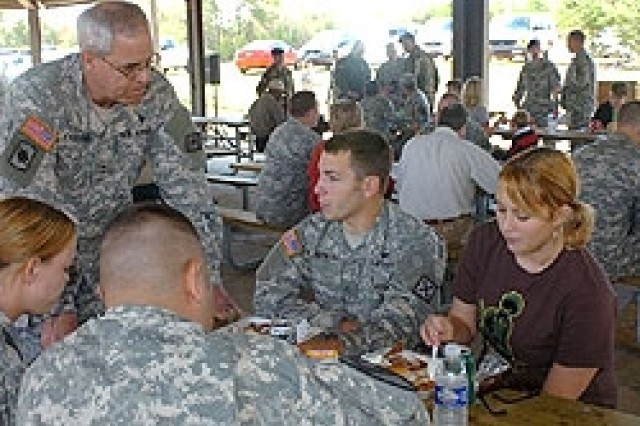 Maj. Gen. Ron Chastain, the adjutant general of the Arkansas National Guard, visits with Soldiers and their families during a going away celebration on Monday at Camp Shelby, Miss.  Family members and Guard leaders gathered at Camp Shelby to bid farewell to the Soldiers, who were deploying with Company D, 1st Battalion, 114th Aviation (Air Traffic Services) of the 77th Aviation Brigade. Over 60 Soldiers strong, the unit departed Camp Shelby, Miss, on Tuesday, Oct. 31, 2006, for their yearlong deployment in Iraq.