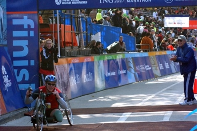 Sgt. Neil Duncan of the Achilles Track Club's Freedom Team blasts passed the finish line of the New York City Marathon.