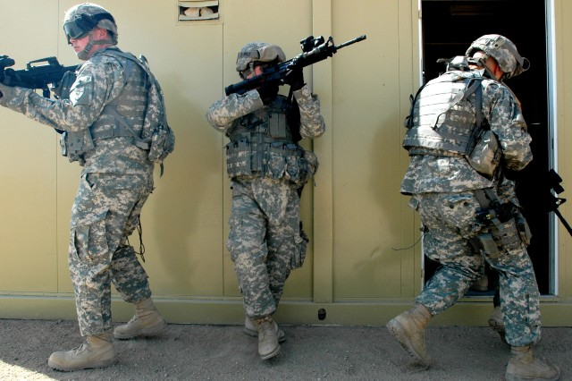 Soldiers with 2nd Battalion, 107th Cavalry Regiment, enter a room during MOUT training, October 18, 2006.