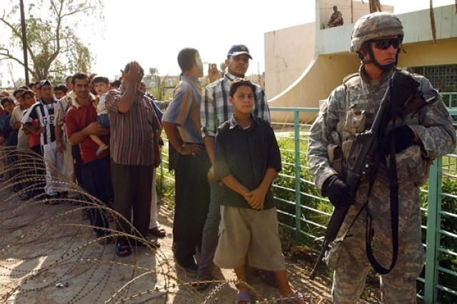 U.S. and Iraqi army doctors and medics provide medical care in Baghdad neighborhood.