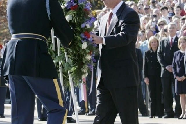President George W. Bush lays a wreath at the Tomb of the Unknowns during Veteran's Day ceremonies Saturday, Nov. 11, 2006, at Arlington National Cemetery in Arlington, Va.