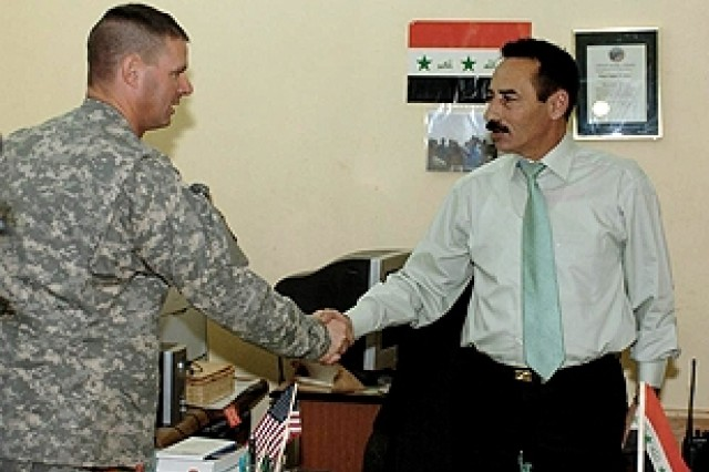 U.S. Army Lt. Col. Malcolm Frost, 3rd Squadron, 4th Cavalry Regiment commander and Tal Afar Mayor Najim Abdullah Abid Al-Jibouri shake hands after a friendly meeting at the mayor's office Oct 22.