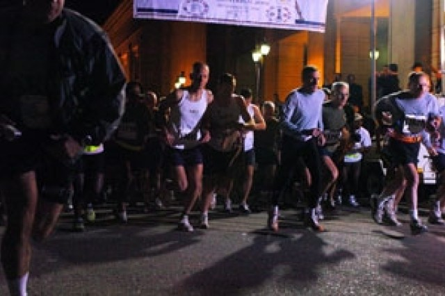 Marathon participants take off during the Baghdad International Memorial Marathon Saturday in the International Zone.