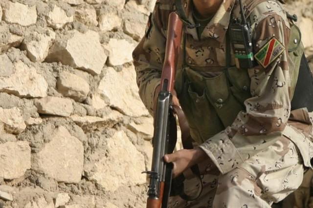 An Iraqi soldier patrols Barwanah.