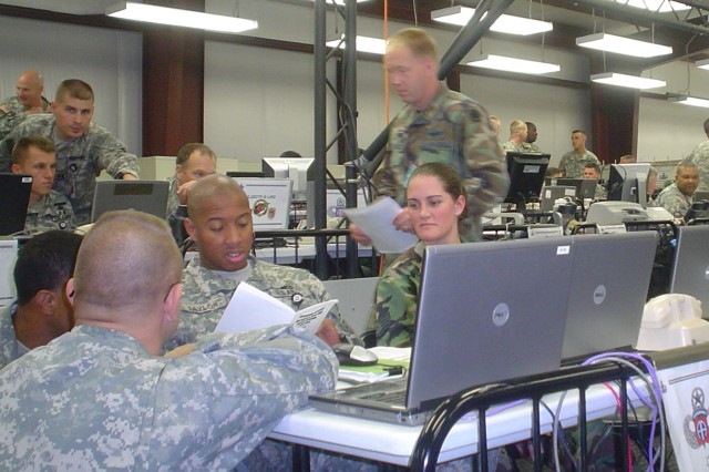 82nd Airborne Division Joint Operations Center personnel meet inside the Unified Endeavor joint operations center to go over battle plans.