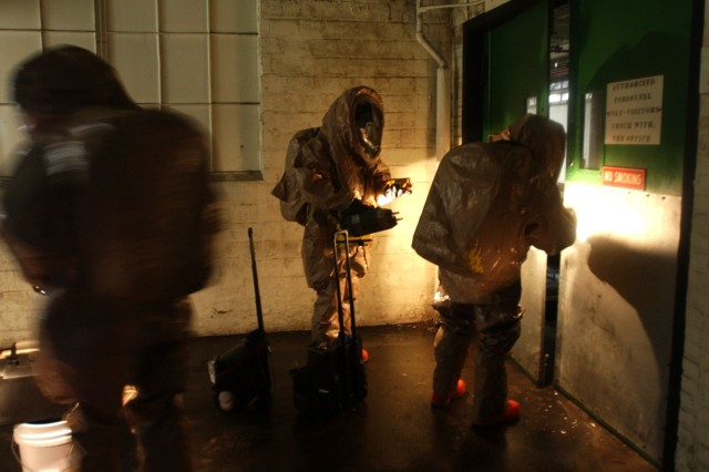 "Soldiers from the 42nd Civil Support Team, ""decontaminate"" a building during a weapons of mass destruction exercise in Enka, N.C."