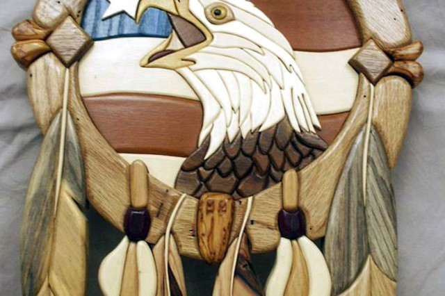 """Albert Fuller of White Sands Missile Range, N.M., takes second place in the novice wood category of the 2006 Army Arts & Crafts Contest with """"America's Dream Catcher Intarsia."""""""