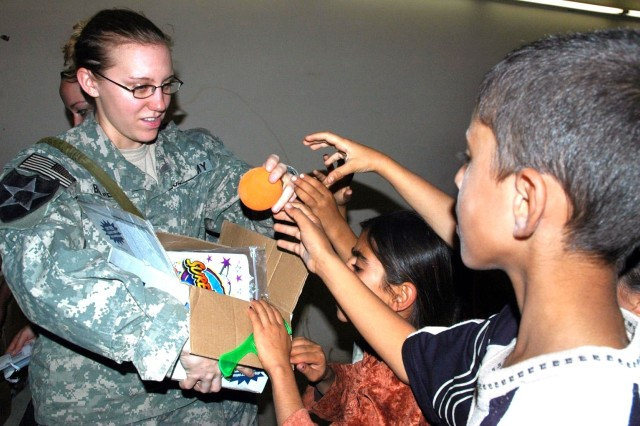 Soldiers bring cheer to others during holiday season