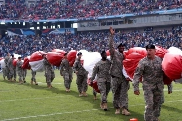 Soldiers from the 101st Airborne Division (Fort Campbell, Ky.), unfurled the Stars and Stripes during the Tennessee Titans game in Nashville Nov. 12.