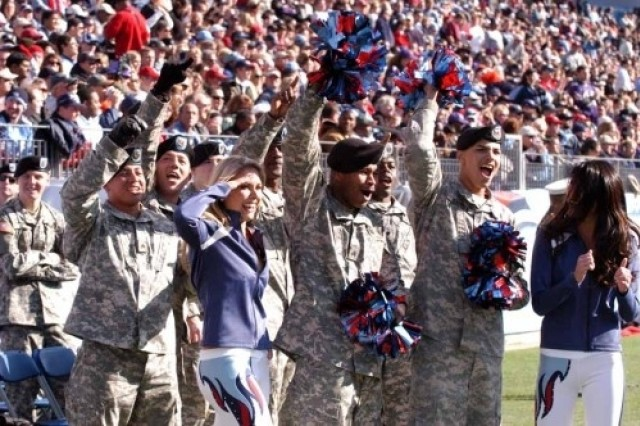 Soldiers from the 101st Airborne Division (Fort Campbell, Ky.), try out their cheerleading skills with the Tennessee Titans cheerleaders during a game Nov. 12.