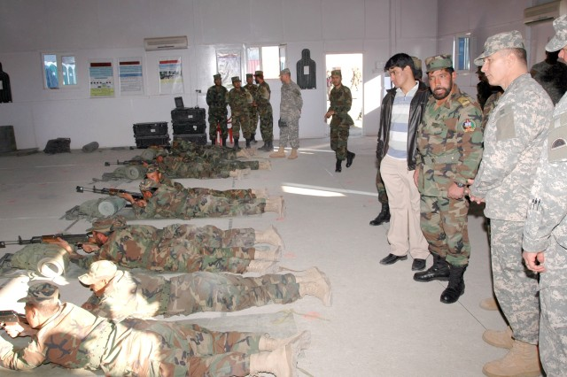 Army Command Sgt. Maj. William J. Gainey, senior enlisted advisor to the chairman, Joint Chiefs of Staff, watches as Afghan National Army trainees practice rifle marksmanship during his visit to Afghanistan Nov. 22.