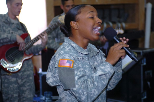 Spc. Kimberly Taylor from the 1st Cavalry Division Band sings during a band performance at Camp Liberty, Iraq. The band is an ensemble that plays different genres of music for Soldiers all over Iraq.