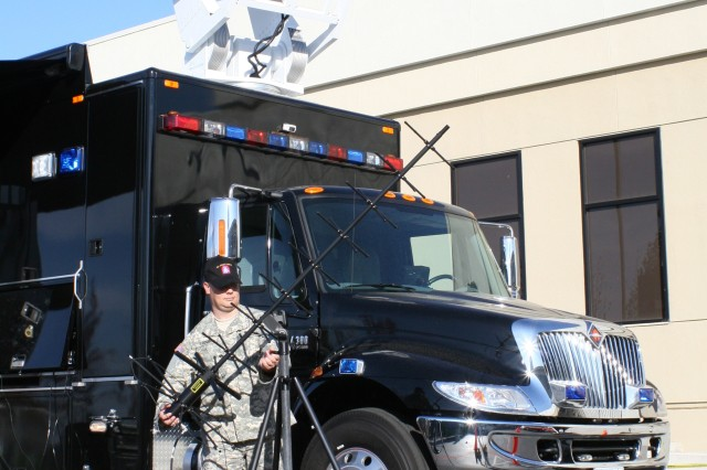 Timothy Thomas, a satellite systems technician at U.S. Army North, sets up communications equipment during exercise Golden Guardian, which ended in California Nov. 19. USARNORTH's Sentinal communications vehicle enables vital communications between DoD elements and the federal and state agencies they support during an emergency or natural disaster.