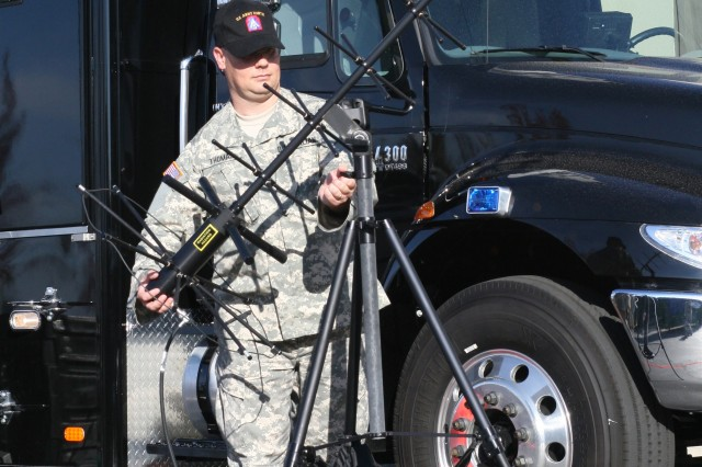 Timothy Thomas, a satellite systems technician at U.S. Army North, sets up communications equipment during exercise Golden Guardian, which ended in California Nov. 19. USARNORTH\'s Sentinal communications vehicle enables vital communications between DoD elements and the federal and state agencies they support during an emergency or natural disaster.""