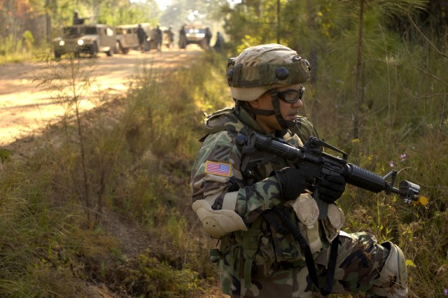1st Sgt. Edward Sanchez, from the 3rd Infantry Division, provides security for a convoy during a mission readiness exercise at Fort Stewart, Ga.