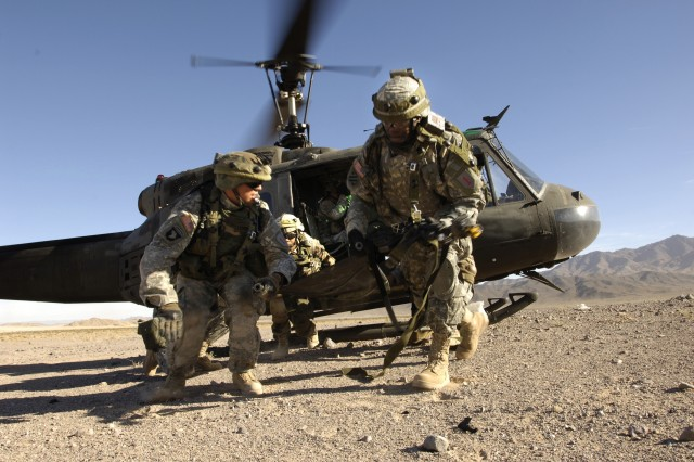 Medics from 2nd Battalion, 16th Infantry Regiment, 4th Brigade, 1st Infantry Division exit a helicopter after loading a simulated casualty, during training at the National Training Center at Fort Irwin, Calif. The Soldiers arrived in Iraq this month.