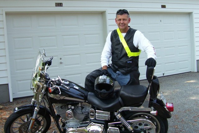 "Pictured next to his Harley Davidson 2003 Super Glide, Brig. Gen. Doyle D. ""Don"" Broome Jr., deputy commanding general of U.S. Army Cadet Command, attributes personal protective equipment and training to saving his life during a motorcycle"