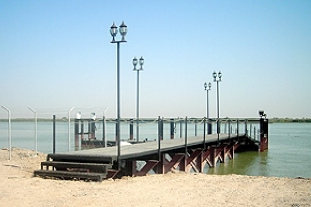 """A boat ramp and pier with a floating dock is part of the new construction on the Al-Faw peninsula, Iraq. It will """"enhance the capabilities of the coast guard, border police and customs police to stem the flow of river borne smuggling activities, such as oil, weapons or terrorists,"""" according to Russell Holeman, chief of engineering and construction for the U.S. Army Corps of Engineer's Gulf Region South District."""