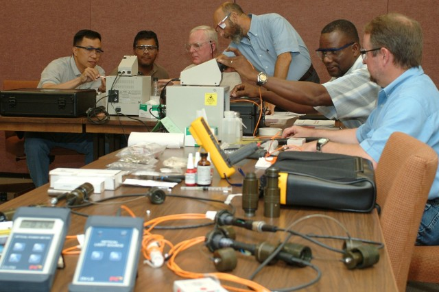 Paul Baumes (standing) teaches a class of depot employees at Tobyhanna Army Depot in Pennsylvania how to build, troubleshoot and repair fiber-optic cables and connectors.