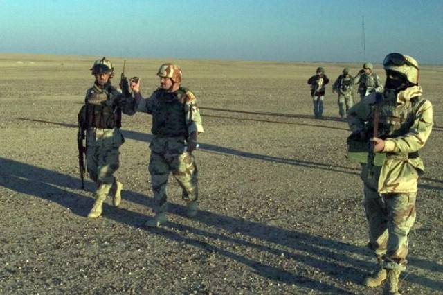 Iraqi Lt. Col. Mukhluff, the operations officer from 1st Battalion, 4th Iraqi Army Division communicates with his soldiers as they secure the landing zone.""