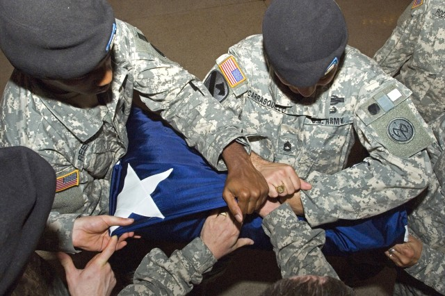 Soldiers from the 69th Infantry Regiment, fold the flag at Grand Central. Since World War I, Soldiers have passed through Grand Central Terminal on the way to the battlefields of Europe, the Pacific and elsewhere, thus adding special significance to the location of the flag folding event.