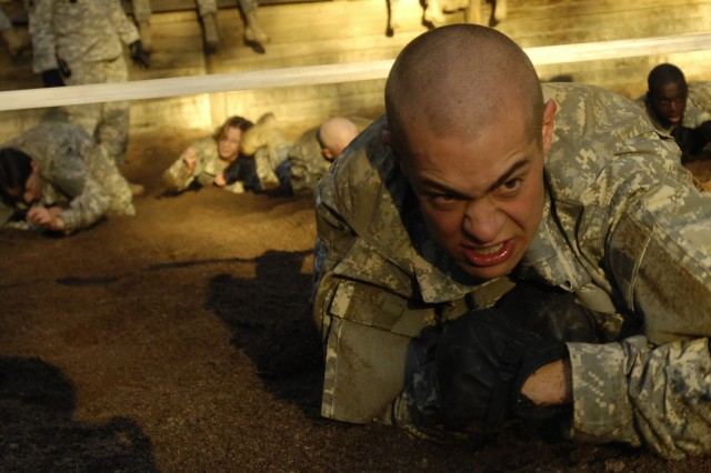 A Soldier in training participates in the obstacle course during U.S. Army basic training at Fort Jackson, S.C. Dec. 5,  2006.