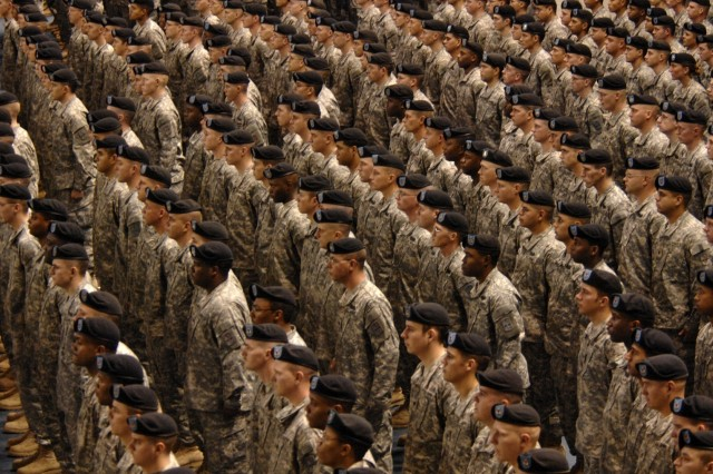 Members of the 172d Stryker Brigade Combat Team stand at attention during a redeployment ceremony near Fort Wainwright, Alaska, Dec. 12.