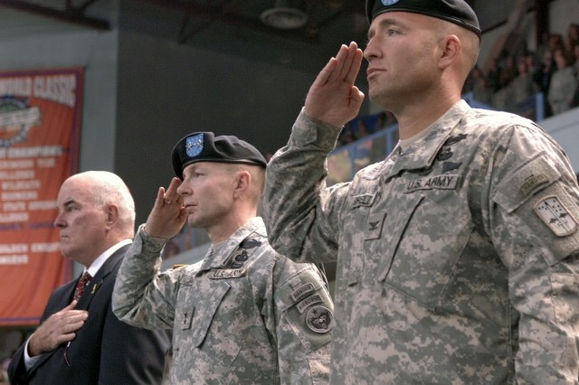 Secretary of the Army Francis J. Harvey, Maj. Gen. Charles Jacoby and Col. Michael Shields render honors during a redeployment ceremony for the 172nd Stryker Brigade Combat Team near Fort Wainwright, Alaska, Dec. 12